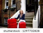 woman waiting on steps outside... | Shutterstock . vector #1297732828