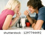 teenage couple on date sharing... | Shutterstock . vector #1297744492