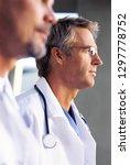 hospital doctors in lab coats... | Shutterstock . vector #1297778752