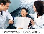 dentist and dental nurse... | Shutterstock . vector #1297778812