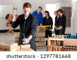 male student with chisel... | Shutterstock . vector #1297781668