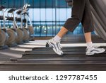 detail of active woman running... | Shutterstock . vector #1297787455