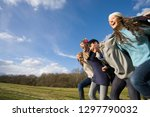 young smiling friends holding... | Shutterstock . vector #1297790032