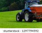 tractor spreading fertilizer on ... | Shutterstock . vector #1297794592