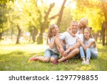 young family with smiles and... | Shutterstock . vector #1297798855
