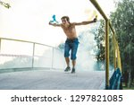 the guy is holding a smoke... | Shutterstock . vector #1297821085