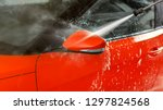 side mirror of red car washed... | Shutterstock . vector #1297824568