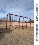 swing set at park in desert | Shutterstock . vector #1297880848