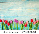 multi color tulips on blue wood ... | Shutterstock . vector #1298036818