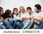 indian asian family sitting... | Shutterstock . vector #1298067178