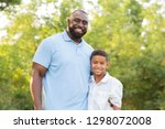 father and his son.   Shutterstock . vector #1298072008