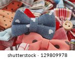bow ties and hair bows pile | Shutterstock . vector #129809978