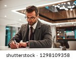 man in hotel check in at... | Shutterstock . vector #1298109358