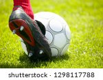 footballer kicks the ball on... | Shutterstock . vector #1298117788