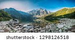 Tatra National Park, Poland. Panorama Famous Mountains Lake Morskie Oko Or Sea Eye Lake In Summer Morning. Five Lakes Valley. Beautiful Scenic View. UNESCO's World Network of Biosphere Reserves - stock photo