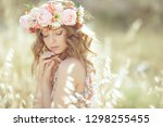 woman with a wreath | Shutterstock . vector #1298255455
