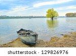 boat on shore of danube | Shutterstock . vector #129826976