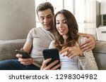 happy young couple sitting on a ... | Shutterstock . vector #1298304982