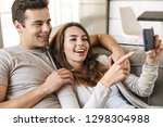 happy young couple sitting on a ... | Shutterstock . vector #1298304988