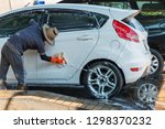 man worker cleaning automobile...   Shutterstock . vector #1298370232