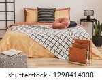open book on pouf and magazine... | Shutterstock . vector #1298414338