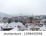roofs of prague with snow in...   Shutterstock . vector #1298433598