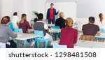 friendly male teacher lecturing ... | Shutterstock . vector #1298481508