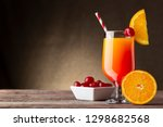 cold tequila sunrise cocktail... | Shutterstock . vector #1298682568