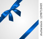 realistic blue bow with ribbons ...   Shutterstock .eps vector #1298713435