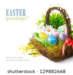 easter egg in basket with... | Shutterstock . vector #129882668