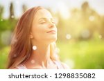 young woman on field under... | Shutterstock . vector #1298835082