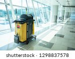 Small photo of Cleaning tools cart wait for maid or cleaner in the airport. Bucket and set of cleaning equipment in the hospital. Concept of service, worker and equipment for cleaner and health