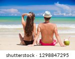 happy young couple sitting and... | Shutterstock . vector #1298847295