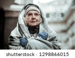 feeling cold. portrait of a... | Shutterstock . vector #1298866015