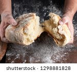 male hands breaking open baked... | Shutterstock . vector #1298881828
