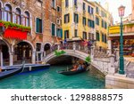 narrow canal with gondola and... | Shutterstock . vector #1298888575