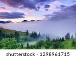 mountains and forest in the fog.... | Shutterstock . vector #1298961715