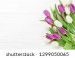 easter greeting card with tulip ...   Shutterstock . vector #1299050065