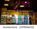 hanging ceiling lamps in a... | Shutterstock . vector #1299066532