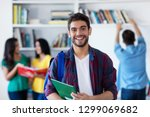 laughing spanish male student... | Shutterstock . vector #1299069682