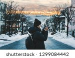 travel woman or photographer... | Shutterstock . vector #1299084442