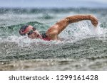 triathlon swim tired swimmer... | Shutterstock . vector #1299161428