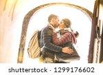 travel couple in love kissing... | Shutterstock . vector #1299176602