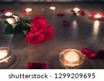 heart candle light red roses in ... | Shutterstock . vector #1299209695