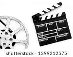 filmings concept. clapperboard... | Shutterstock . vector #1299212575