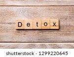 detox word written on wood... | Shutterstock . vector #1299220645