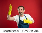cleaning day today. bearded guy ... | Shutterstock . vector #1299245908