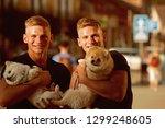 family bonding time. twins men... | Shutterstock . vector #1299248605