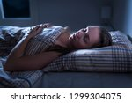 calm and peaceful woman... | Shutterstock . vector #1299304075