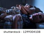 snoring at night. sleep apnea.... | Shutterstock . vector #1299304108